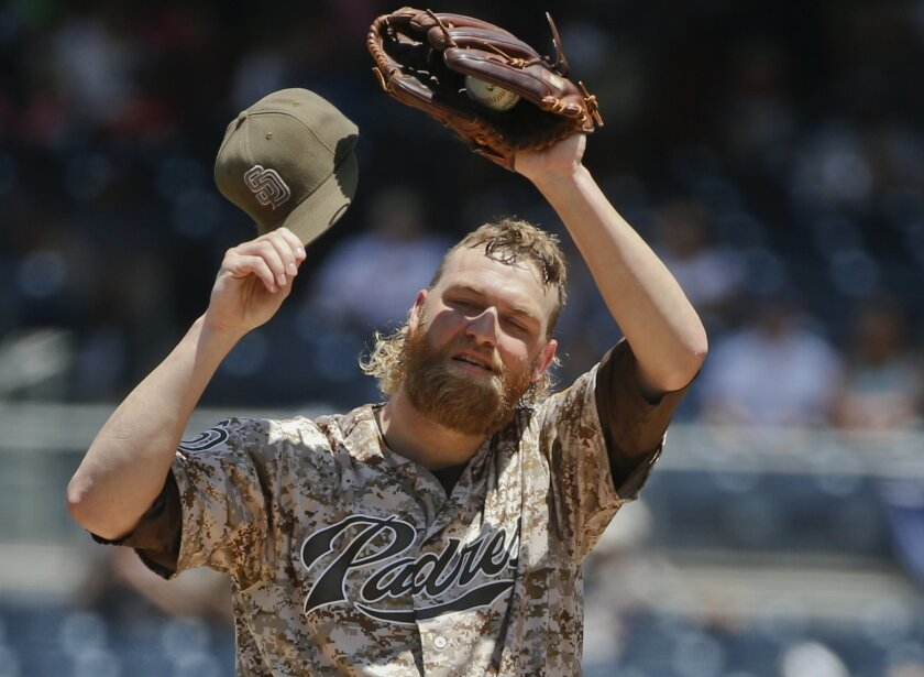 San Diego Padres starting pitcher Andrew Cashner stops to wipe away the sweat while pitching in a jam against the Philadelphia Phillies in the first inning of a baseball game, Sunday, Aug. 9, 2015, in San Diego. (AP Photo/Lenny Ignelzi)