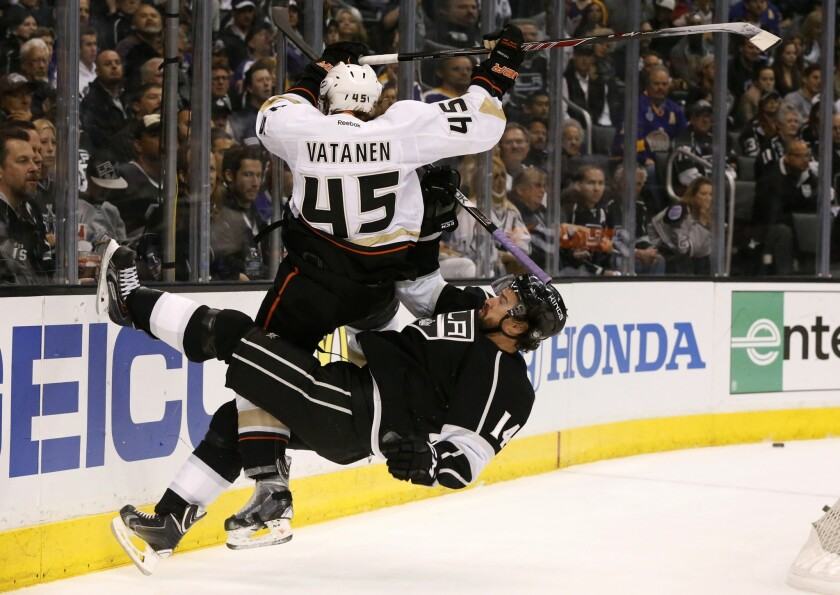 Ducks defenseman Sami Vatanen and Kings winger Justin Williams collide behind the goal while in pursuit of the puck in the first period.