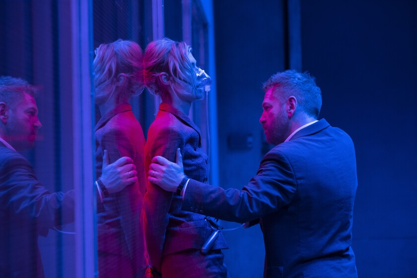 "Elizabeth Debicki and Kenneth Branagh in the Warner Bros.' action epic ""Tenet."""