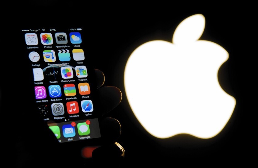 Topping the list of expected Apple announcements Monday is the iPhone 5SE, a model purported to be smaller and less expensive than the iPhone 6 or 6s. Above, an iPhone in front of the Apple logo.