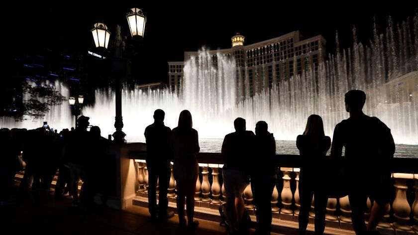 LAS VEGAS, CA - DECEMBER 1, 2017 -- Visitors watch the Fountains of Bellagio show in front of the Be