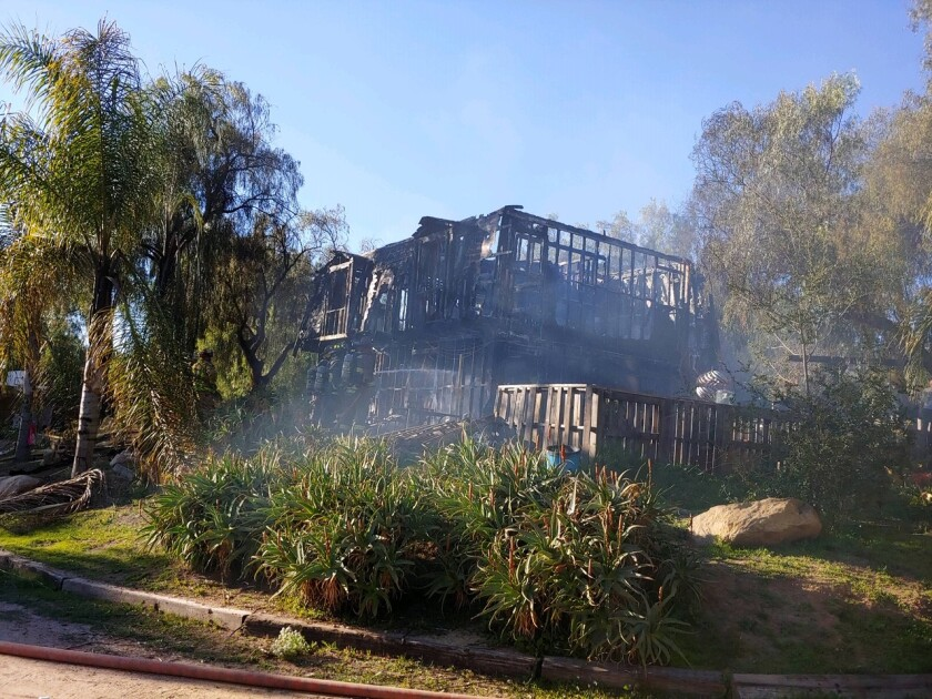 Fire destroyed this two-story home on Dentro De Las Lomas Road in Bonsall Saturday afternoon. Firefighters from several agencies kept the flames from spreading to the landscaping and neighbors' homes.