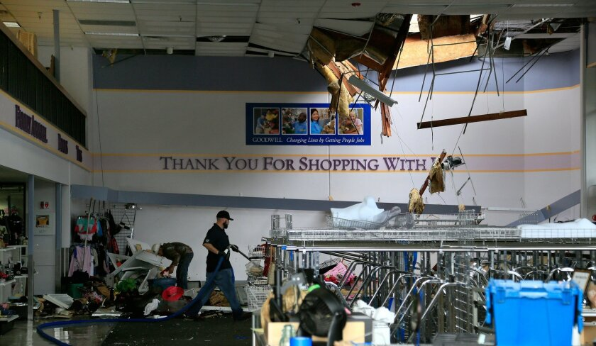 Part of the roof of the Goodwill Industries retail store in Escondido collapsed late Wednesday night during the storm.