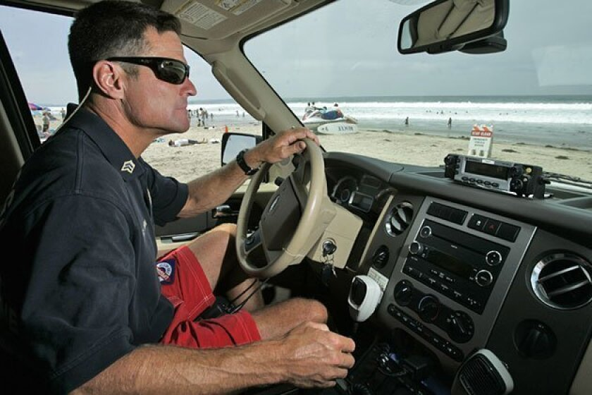 San Diego lifeguard Sgt. Casey Owens patrolled Pacific Beach on a recent Saturday. The city employs about 230 lifeguards, with 70 full-timers, among the country's largest such forces. (K.C. Alfred / U-T)