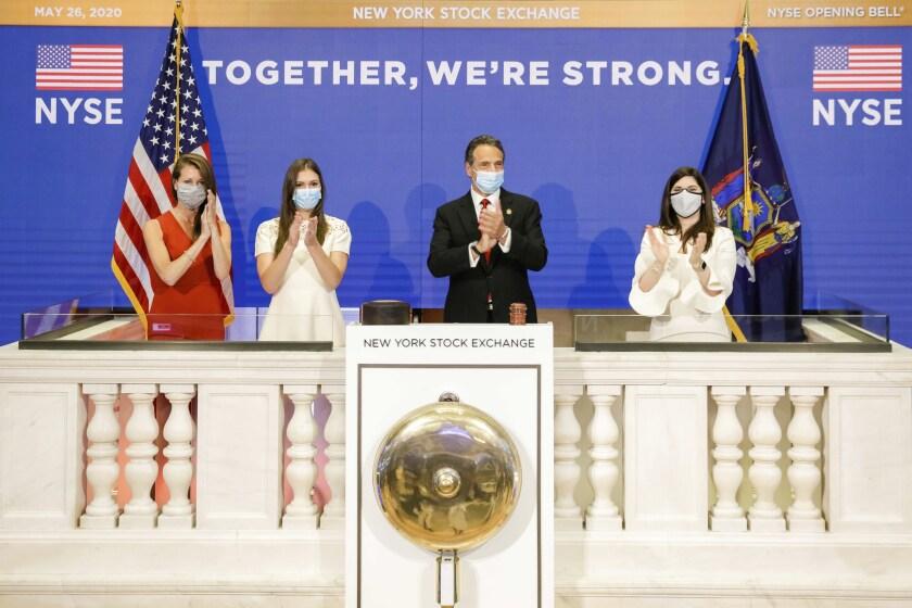 New York Gov. Andrew Cuomo rings the New York Stock Exchange opening bell