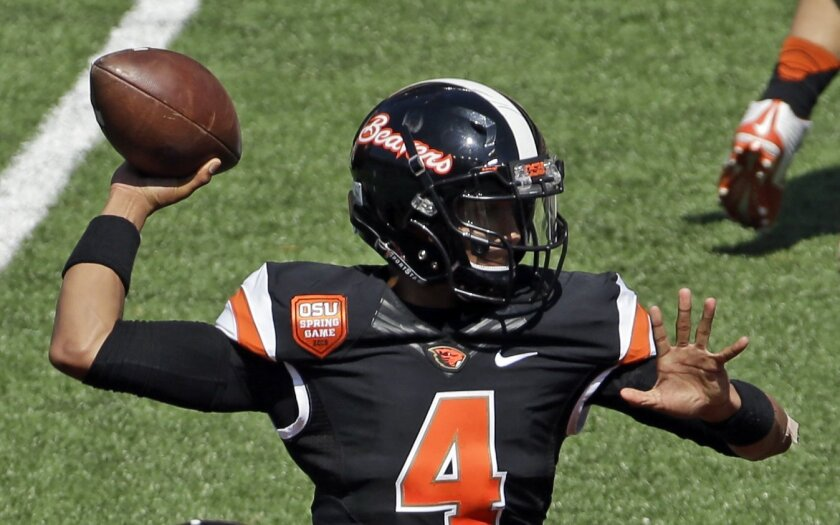 FILE - In this April 18, 2015, file photo, Oregon State quarterback Seth Collins passes during the second half of the NCAA college football team's spring game in Corvallis, Ore. Three players are vying for the Beavers' starting quarterback position and about the only thing certain is that the ultimate starter will be someone who has never before played in a college game. (AP Photo/Don Ryan, file)