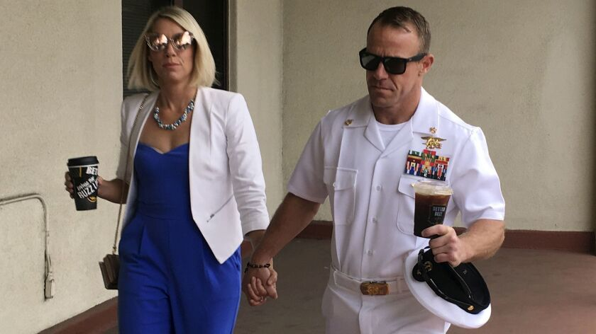 Navy Special Operations Chief Edward Gallagher, right, walks with his wife, Andrea Gallagher as they