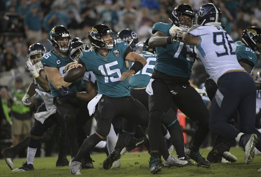 Jacksonville Jaguars quarterback Gardner Minshew II (15) throws a pass against the Tennessee Titans during the second half on Thursday in Jacksonville, Fla.