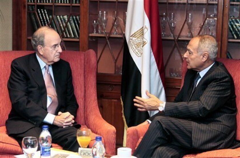 U.S. Mideast envoy George Mitchell, left, meets with Egyptian Foreign Minister Ahmed Aboul Gheit, in Cairo, Egypt, Sunday, Oct. 11, 2009. Talks come within the framework of efforts aimed at reviving the Middle East peace process. (AP Photo/Amr Nabil)