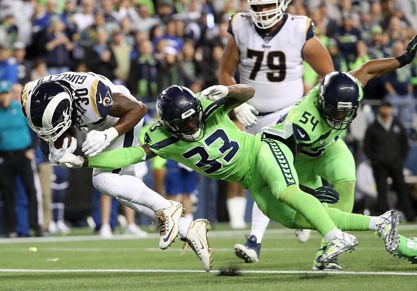 Rams running back Todd Gurley rushes for a first down ahead of Seattle's Tedric Thompson during the third quarter Thursday.