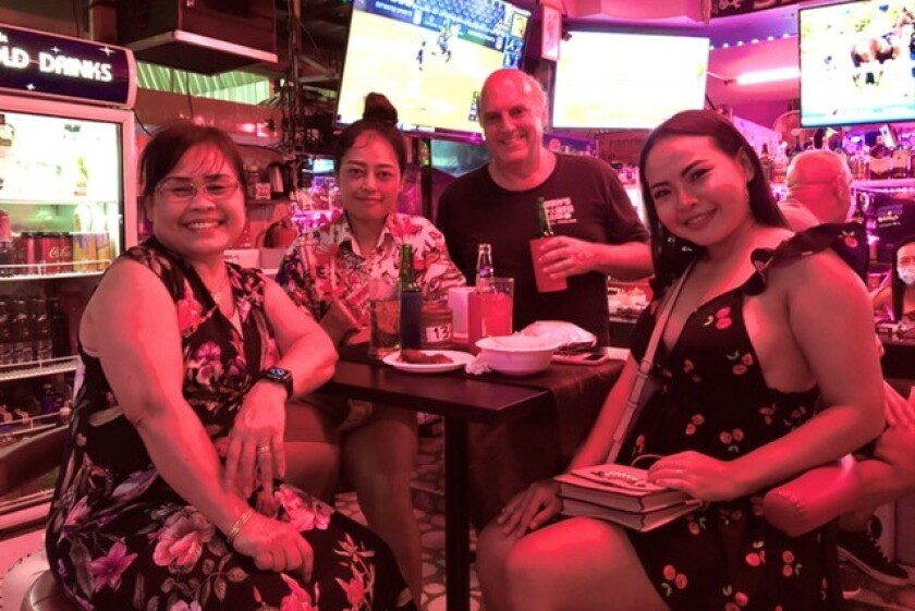 Former sportswriter Danny Knobler with his family at his sports bar, Danny's Sports Bar, in Pattaya, Thailand.