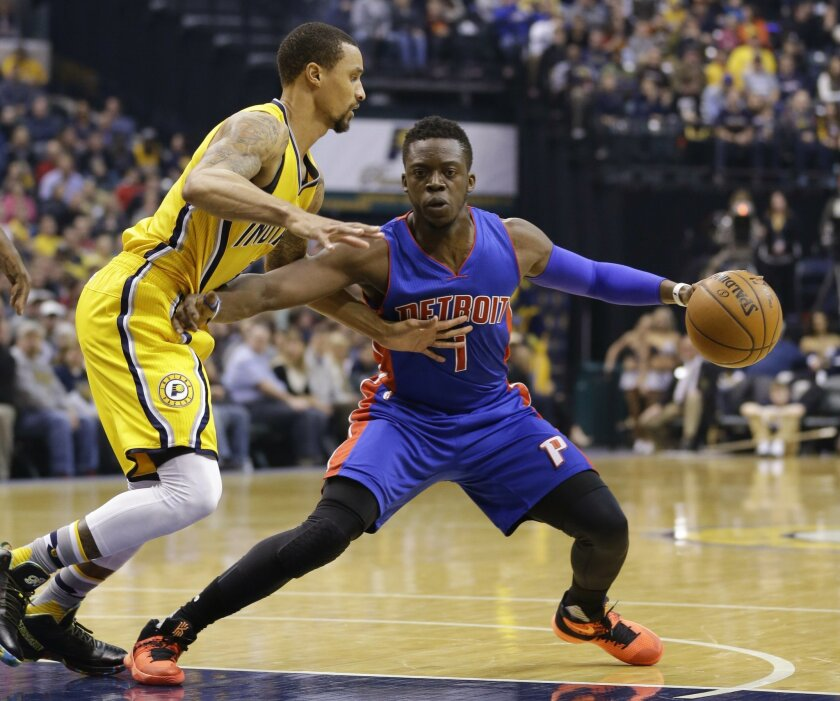 Indiana Pacers guard George Hill defends Detroit Pistons guard Reggie Jackson (1) during the first half of an NBA basketball game in Indianapolis, Saturday, Feb. 6, 2016. (AP Photo/Michael Conroy)