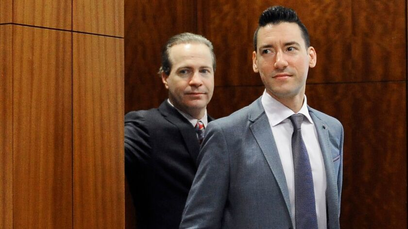 FILE - In this April 29, 2016 file photo, David Robert Daleiden, right, leaves a courtroom after a h