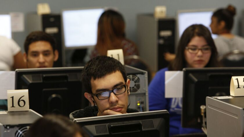 LOS ANGELES, CA. - FEBRUARY 19, 2015: Bryan Casillas (CQ),center, concentrates as 11th grade student