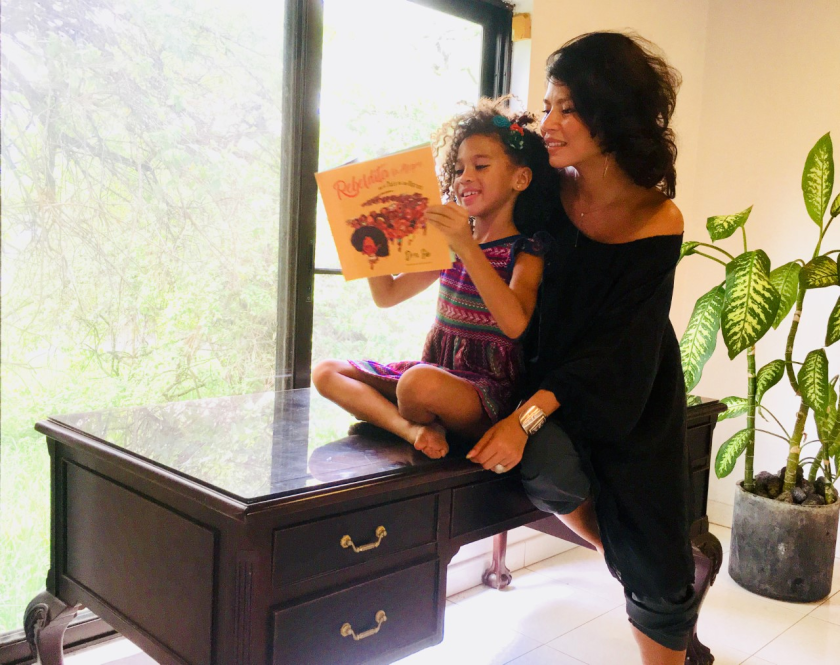 A child and her mother read