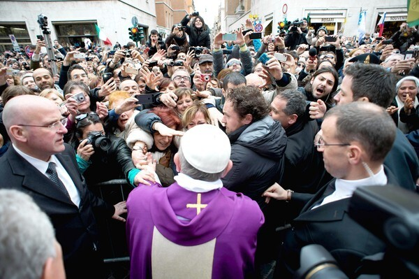 Pope Francis greets the faithful after celebrating Sunday Mass in Vatican City.