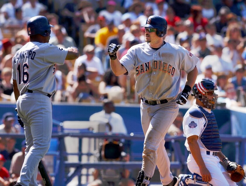 San Diego Padres' Ray Lankford congratulates Phil Nevin, right, after Nevin hit a solo home run off of Los Angeles Dodgers relief pitcher Terry Mulholland in the seventh inning Sunday, April 21, 2002, in Los Angeles. The Padres blanked the Dodgers 5-0.