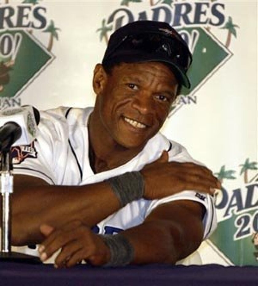 Rickey Henderson, shown in this Oct. 4, 2001 file photo after he broke the all-time runs scored record, was elected to the Baseball Hall of Fame Monday along with Jim Rice.<br> <em>Kevork Djansezian/AP Photo</em>