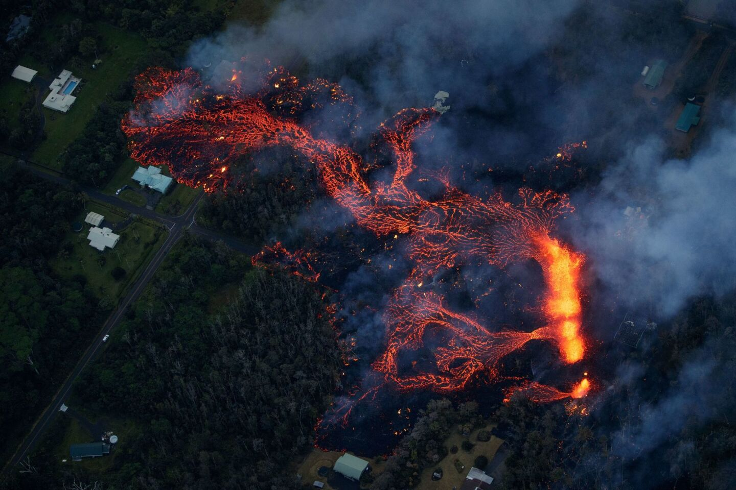 Volcanic activity continues along Kilauea's east rift zone, as a robust fissure eruption in Leilani Estates sends a massive flow into the subdivision, consuming all in its path, near Pahoa, Hawaii on May 6, 2018.