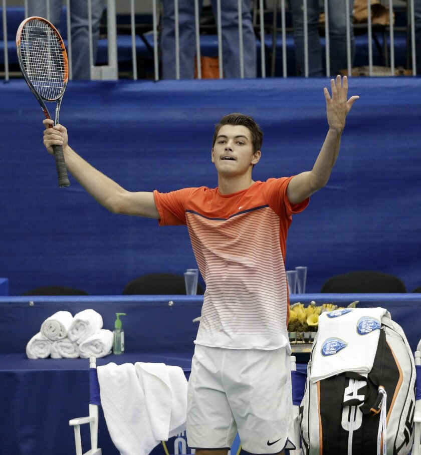 Taylor Fritz celebrates after defeating Benjamin Becker, of Germany, 6-4, 5-7, 7-6 (5)  in a quarterfinal at the Memphis Open tennis tournament Friday, Feb. 12, 2016, in Memphis, Tenn. (AP Photo/Mark Humphrey)