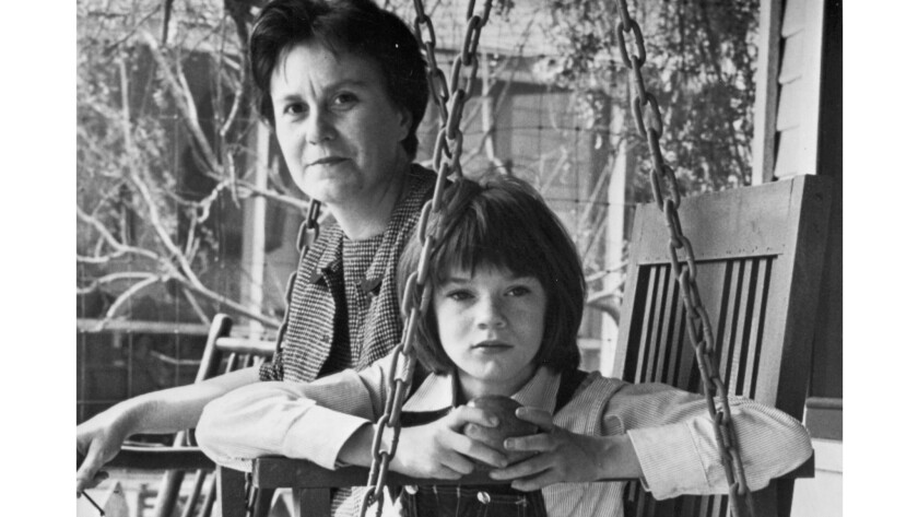 """Harper Lee on the set of """"To Kill a Mockingbird"""" with Mary Badham, who played Scout. Will Lee's new novel find a place in Hollywood?"""