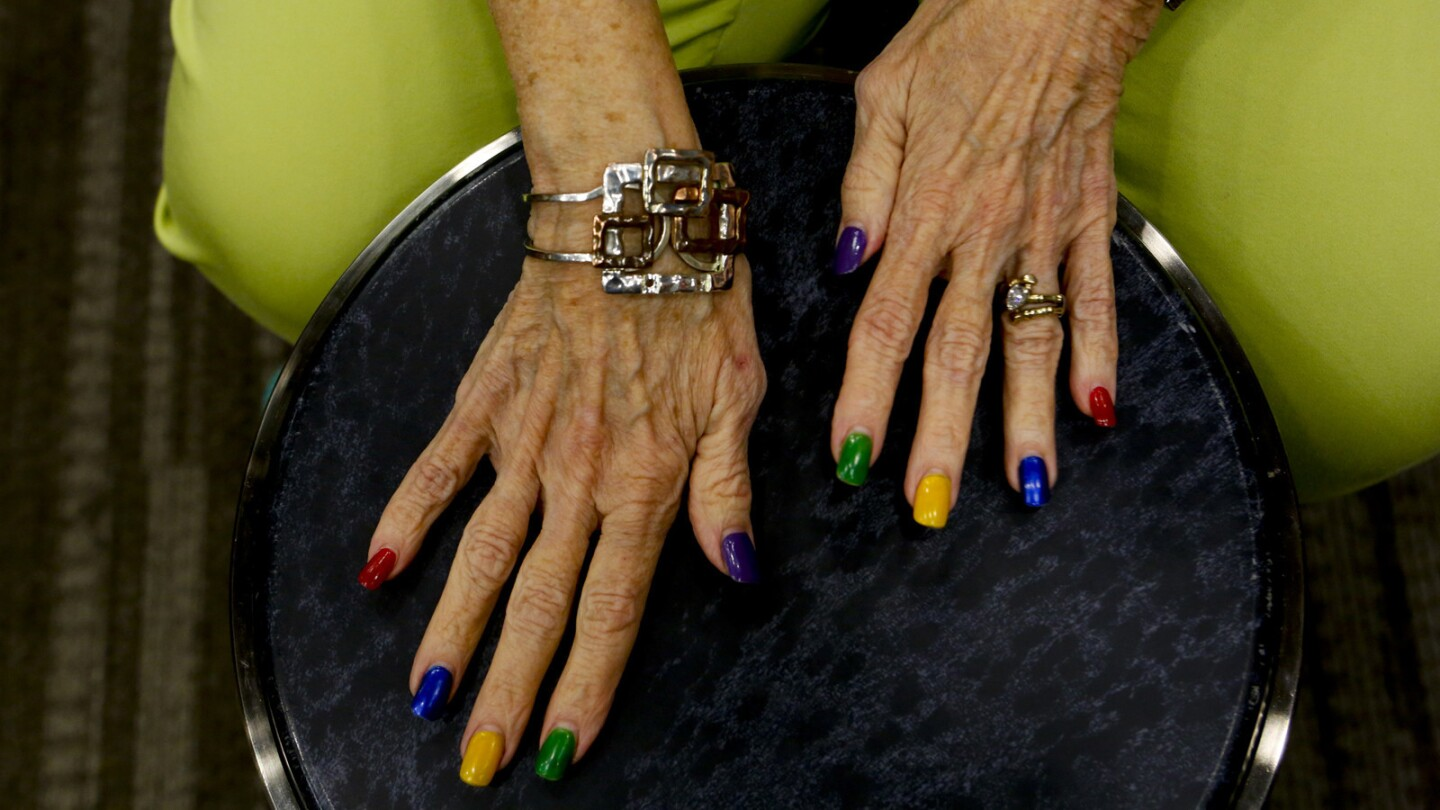 """Vicki Finn keeps the rhythm during a drum circle class at the NoHo Senior Arts Colony. She calls her hands """"happy hands"""" because her colorful nail polish makes people smile."""