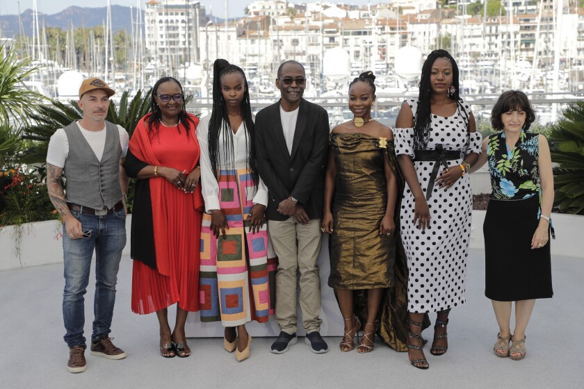 Mathieu Giombini, from left, Hadje Fatime Ngoua, Rihane Khalil Alio, director Mahamat-Saleh Haroun, Achouackh Abakar Souleymane, Bria Gomdigue and producer Florence Stern pose for photographers at the photo call for the film 'Lingui' at the 74th international film festival, Cannes, southern France, Friday, July 9, 2021. (Photo by Vianney Le Caer/Invision/AP)