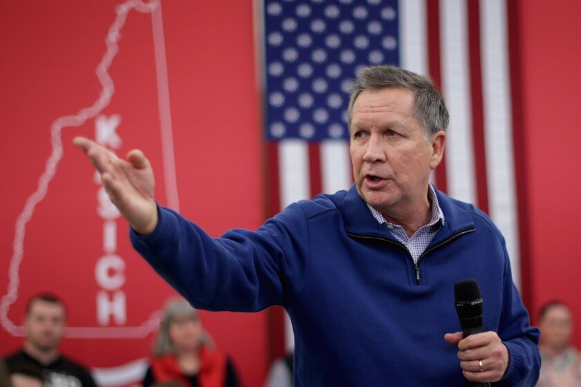 Republican presidential candidate and Ohio Gov. John Kasich campaigns in Bow, N.H.