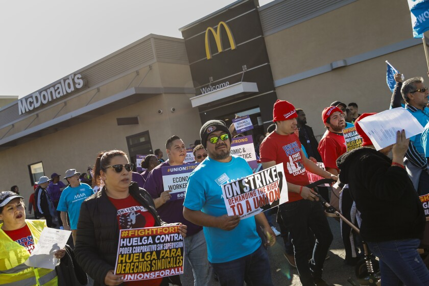 McDonald's workers rally to demand higher wages and union rights.
