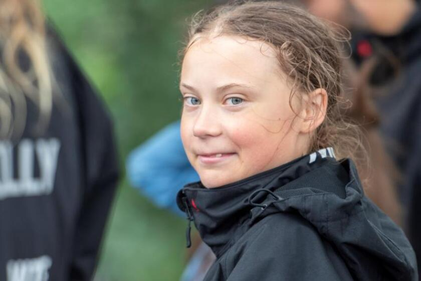 16-year-old climate change activist Greta Thunberg looks on at a press conference after she arrives on the Malizia II boat in New York, USA 28 August 2019. EFE/EPA/Corey Sipkin