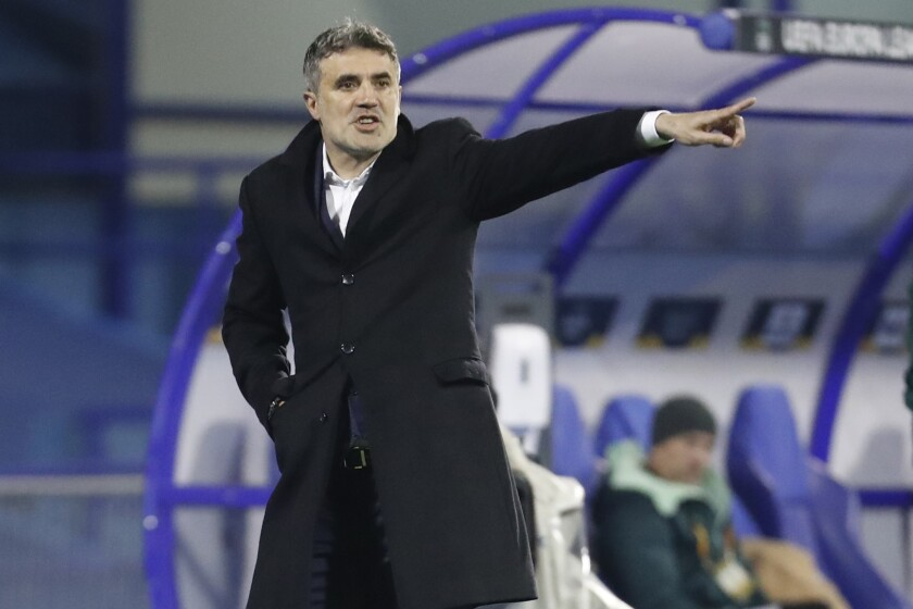 *FILE* In this Thursday, Feb. 25, 2021 file photo, Dinamo head coach Zoran Mamic gestures during the Europa League round of 32 second leg soccer match between Dinamo Zagreb and Krasnodar at the Maksimir stadium in Zagreb, Croatia. According to a statement late Monday March 15, 2021, Mamic has resigned after the Croatian supreme court confirmed his nearly five-year prison sentence for tax evasion and fraud, just days before a Europa League match against Tottenham.(AP Photo/Darko Bandic, File)