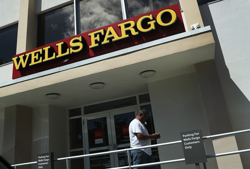 Aggressive sales tactics by Wells Fargo & Co. employees led to a $185-million settlement package with federal and state regulators last week. Above, a branch in Miami.