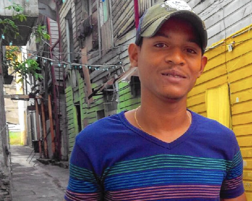 """Luis """"Ricky"""" James, a former gang member, now leads tours through Panama City's Casco Viejo district."""