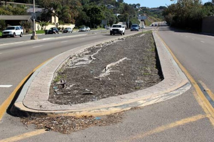 The median strip on the La Jolla Parkway known as 'The Teardrop' will be cleaned out and filled with cobblestone-like pavers. Photo: Dave Schwab
