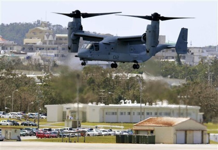 An Osprey aircraft arrives at Marine Corps Air Station Futenma in Ginowan, Okinawa, Monday, Oct. 1, 2012. Okinawans rallied against the U.S. deployment of Osprey hybrid aircraft to the southern Japanese island amid renewed safety concerns. (AP Photo/Kyodo News) JAPAN OUT, MANDATORY CREDIT, NO LICENSING IN CHINA, FRANCE, HONG KONG, JAPAN AND SOUTH KOREA