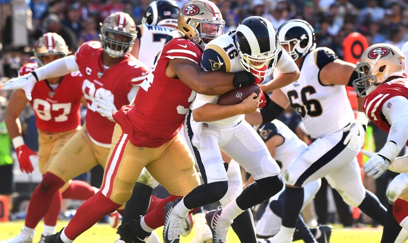 Rams quarterback Jared Goff is sacked by 49ers defensive end Solomon Thomas during the third quarter of the Rams' 20-7 loss at the Coliseum on Sunday.