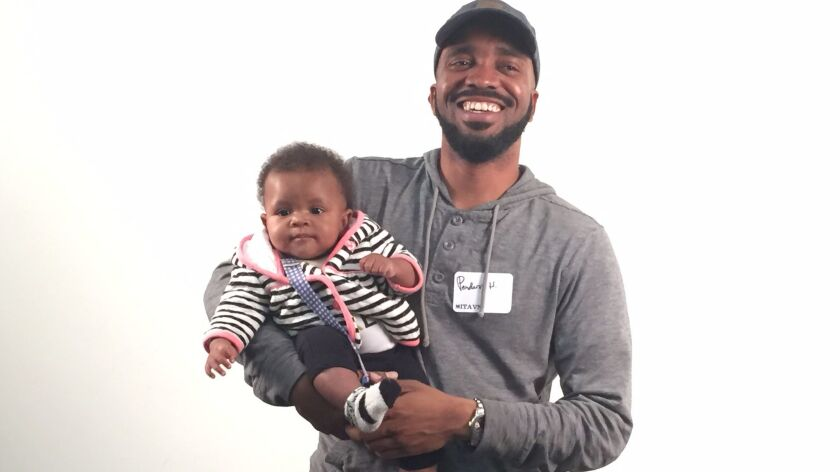 """""""OG Told Me"""" author Pendarvis Harshaw with his 6-month old daughter, Zuri. (Not shown: Her mother, T"""