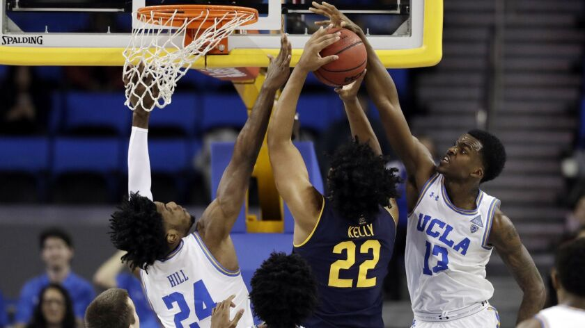 UCLA guard Kris Wilkes and forward Jalen Hill block a shot from California forward Andre Kelly during a Bruins win on Jan. 5.