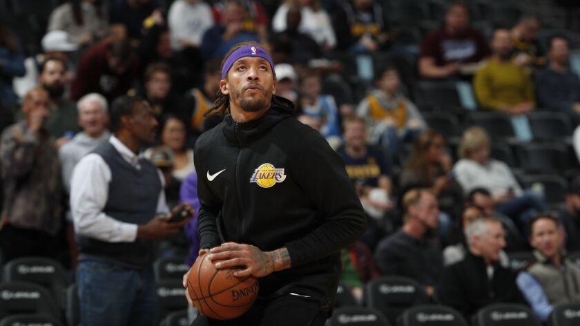 Los Angeles Lakers forward Michael Beasley (11), r m