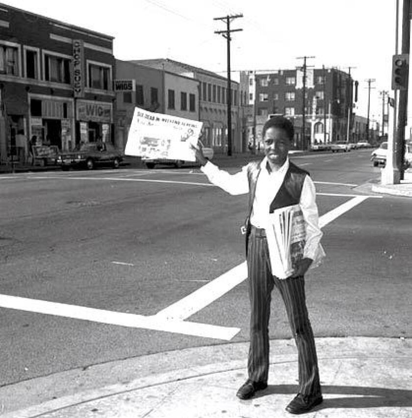 A news vendor in 1964 sells the Los Angeles Sentinel, one of the largest Black newspapers in Southern California.