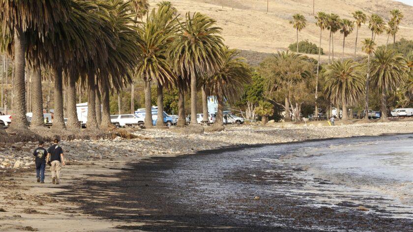 GOLETA, CA MAY 19, 2015 -- Santa Barbara residents walk the oil coated beach at Refugio State Beach