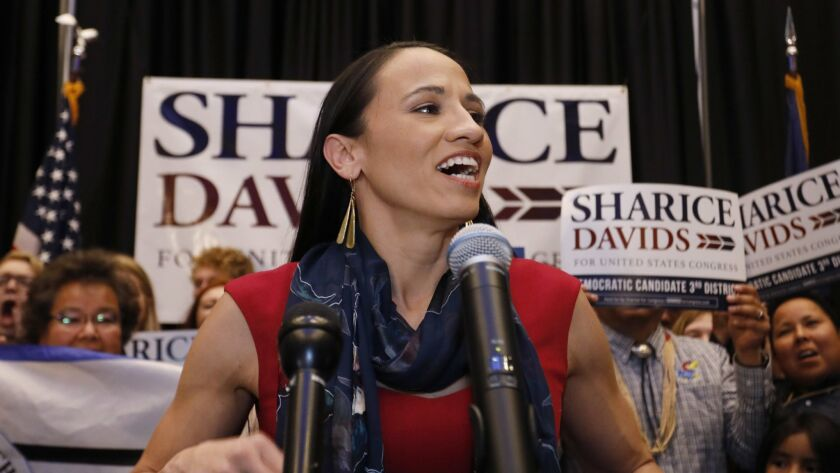Democrat House candidate Sharice Davids speaks to supporters at a victory party in Olathe, Kan., Tue