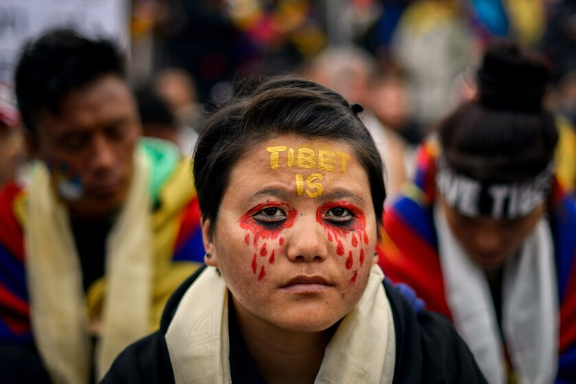 Demonstrators' protests against alleged Chinese rights abuses in Tibet did little to dissuade the U.N. General Assembly on Tuesday from electing China to a three-year term on the world body's Human Rights Council. This protester was taking part in a demonstration outside the U.N. building in Geneva in October.