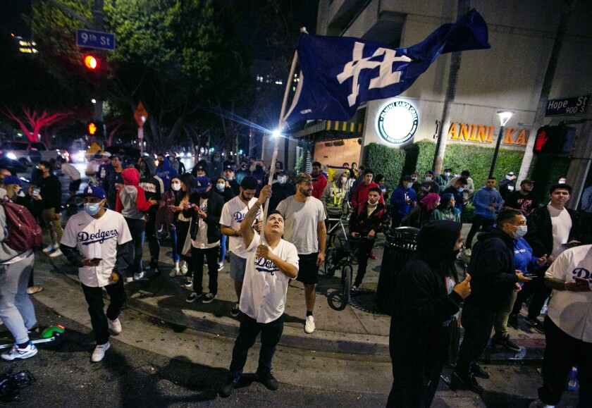 Fans celebrate after the Dodgers defeat the Rays in Game 6 to win the World Series.
