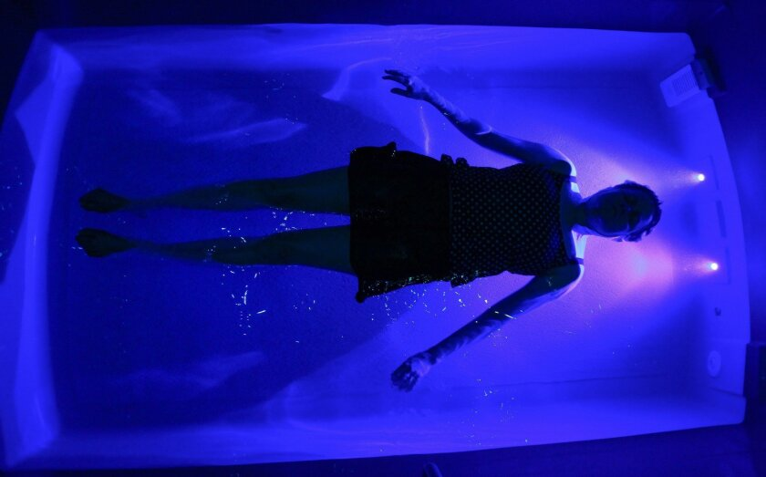 San Diego Union-Tribune reporter Karla Peterson tries out a flotation tank at Float North County in Solana Beach. This tank is in an Ocean Float Room with 7-foot-high ceilings. Floating, which is usually done without bathing suits, involves floating in warm water that is high in salinity for buoyancy. It is used for pain management, stress reduction, and as a personal development tool.