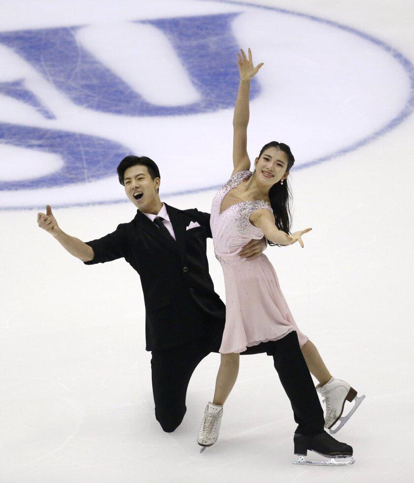 China's Wang Shiyue and Liu Xinyu perform during the Ice Dance Short Dance competition at the Taiwan ISU Four Continents Figure Skating Championships in Taipei, Taiwan, Thursday, Feb. 18, 2016. (AP Photo/Wally Santana)