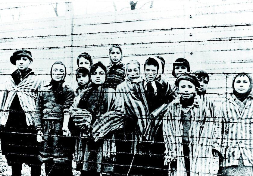 The Soviets liberated the Auschwitz concentration camp in Poland in January 1945, months before the defeat of Nazi Germany and the end of the war in Europe. The Nazis had fled Auschwitz, leaving behind thousands of ill and malnourished prisoners, including children. AP file