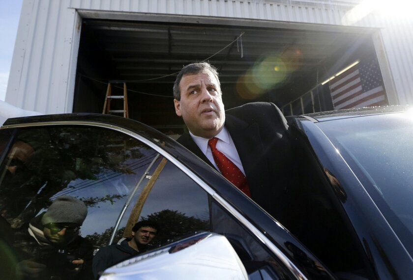 FILE - In this Feb. 6, 2016, file photo, Republican presidential candidate, New Jersey Gov. Chris Christie gets in his car after a campaign event in Bedford, N.H. New Jersey taxpayers have spent more than $10 million for legal services for Christie's administration in the George Washington Bridge lane closure case still pending against two former Christie allies. The updated total became known late Friday, Feb. 19 after the state released details for the first time on the more than $2 million paid over the past two years to a firm that's also owed money by the Republican governor's 2013 re-election campaign. (AP Photo/Elise Amendola, File)