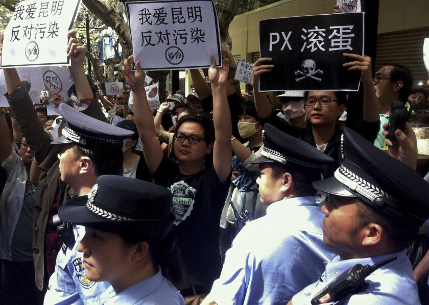 Chinese protesters rally against a planned refinery project in Kunming.