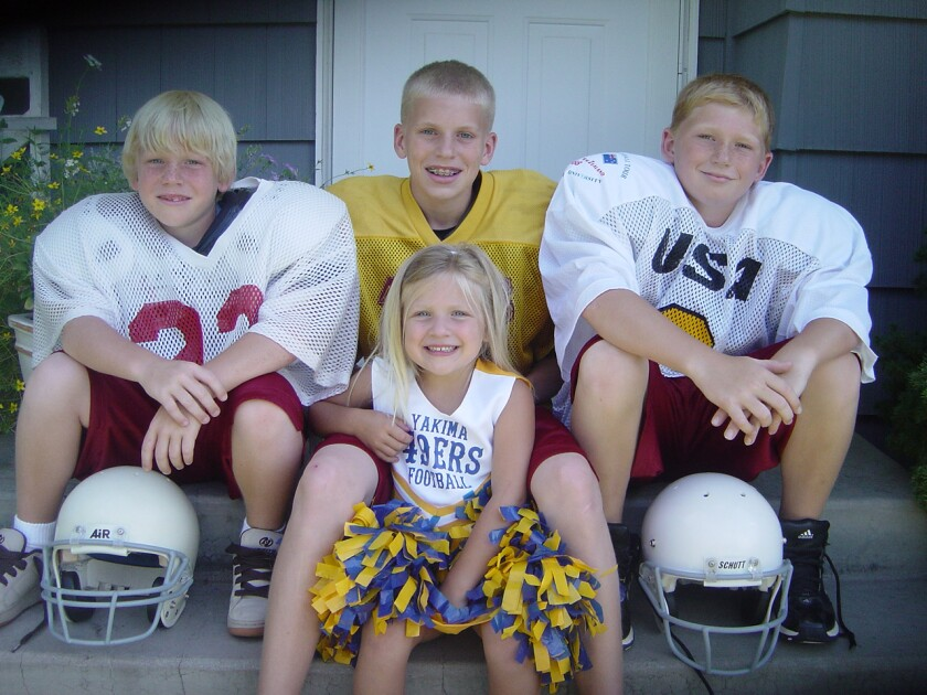 Cooper Kupp, top center, sits with siblings (from left) Kobe, Katrina and Ketner in the early 2000s.